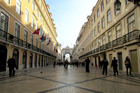 Pedestrian street in Baixa area, looking toward triumphal arch