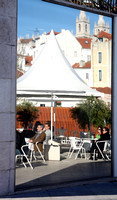 Open-air cafe by Plaza Largo Portas do Sol