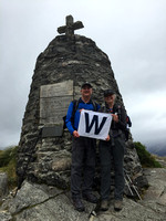"The ""W"" flag makes its first appearance at McKinnon's memorial"