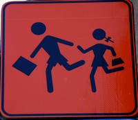 Watch for children...or watch for the businessman with briefcase running away with little girl??